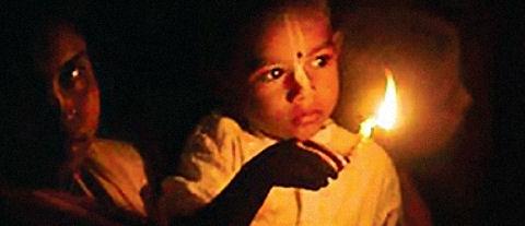 Damodar Masa - offering lights to Krishna